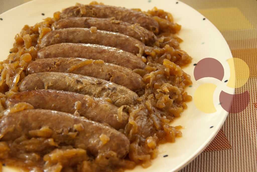 slow cooked sausages in beer and onion.